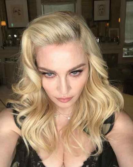 La divertida respuesta de Madonna a una actriz que se coló en su foto